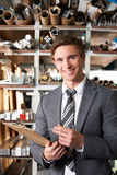Businessman Checking Stock In Warehouse Royalty Free Stock Photos