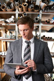 Businessman Checking Stock In Warehouse Using Digital Tablet royalty free stock image