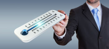 Businessman checking the temperature drop 3D rendering. Businessman checking the temperature drop with a thermometer 3D rendering Royalty Free Stock Photo