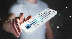 Businessman checking the temperature drop 3D rendering Royalty Free Stock Photography