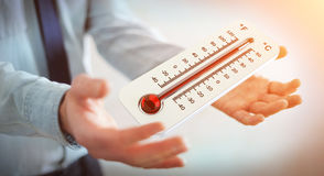 Businessman checking the temperature rise 3D rendering. Businessman checking the temperature rise with a thermometer 3D rendering Royalty Free Stock Photos