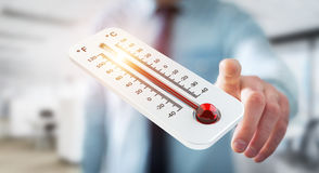 Businessman checking the temperature rise 3D rendering. Businessman checking the temperature rise with a thermometer 3D rendering Stock Photos