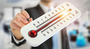 Businessman checking the temperature rise 3D rendering. Businessman checking the temperature rise with a thermometer 3D rendering Stock Photography
