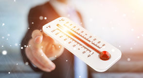 Businessman checking the temperature rise 3D rendering. Businessman checking the temperature rise with a thermometer 3D rendering Stock Photo