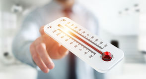 Businessman checking the temperature rise 3D rendering. Businessman checking the temperature rise with a thermometer 3D rendering Royalty Free Stock Photo