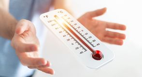 Businessman checking the temperature rise 3D rendering. Businessman checking the temperature rise with a thermometer 3D rendering Royalty Free Stock Images
