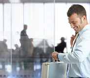 Businessman checking time Stock Images