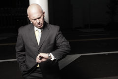 Businessman checking the time Royalty Free Stock Photo