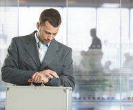 Businessman checking time Stock Image