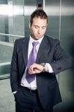 Businessman checking time Royalty Free Stock Image
