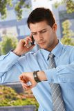 Businessman checking time Royalty Free Stock Photo