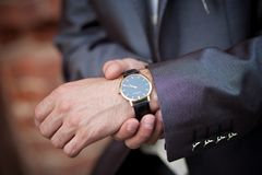 Businessman checking the time Royalty Free Stock Image