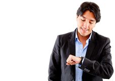 Businessman checking the time Royalty Free Stock Images