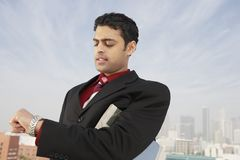 Businessman Checking Time Stock Photography