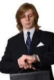Businessman checking time Royalty Free Stock Images