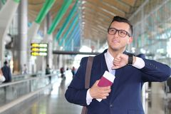 Businessman checking the time in the airport Stock Photography