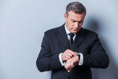 Businessman checking the time. Royalty Free Stock Image
