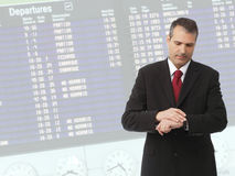 Businessman checking time on his watch Royalty Free Stock Images
