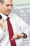 Businessman checking time on his watch Royalty Free Stock Image