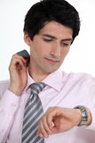 Businessman checking the time Stock Photos