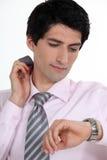 Businessman checking the time Stock Photos