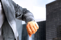Businessman checking time on his watch . Stock Images