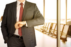 Businessman checking time on his watch at office.  Stock Photo