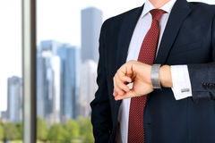 Businessman  checking time on his watch at office.  Royalty Free Stock Image