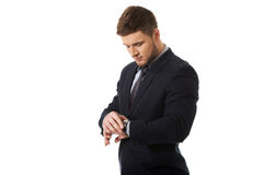 Businessman checking time on his wrist watch. Royalty Free Stock Photo