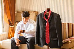 Businessman checking time on his wristwatch. Stock Image