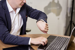 Businessman checking time on his wristwatch. men`s hand with a w stock images