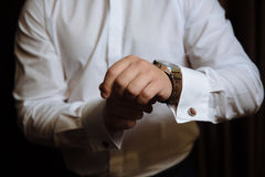 Businessman checking time on his wristwatch. men`s hand with a watch. Royalty Free Stock Image