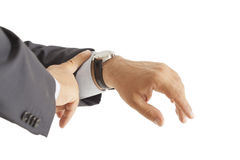 Businessman checking the time on isolated Royalty Free Stock Photos