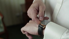 Businessman checking time from watch stock footage