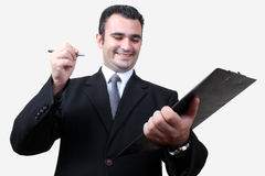 Businessman checklist. Business man, happily agrees checklist Stock Photography