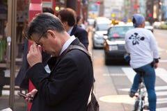 Businessman checks his mobile phone Stock Photos