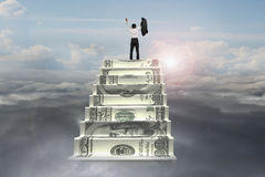 Businessman cheer on top of money stairs with sunlight cloudscap Royalty Free Stock Photography