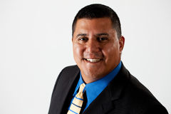 Businessman:  Cheerful Hispanic Businessman. Series of a Hispanic businessman in suit, isolated on white, with props, in various poses Stock Images