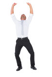 Businessman cheering with arms up. On white background Stock Photography