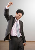 Businessman cheering and celebrating his success Royalty Free Stock Photo