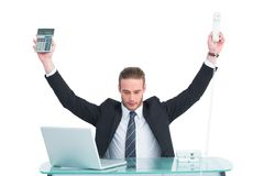 Businessman cheering holding calculator and telephone Royalty Free Stock Image