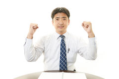 Businessman cheering Stock Image