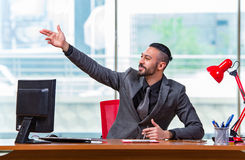 The businessman cheering saluting in the office. Businessman cheering saluting in the office Royalty Free Stock Photos