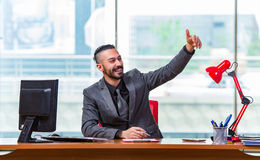 The businessman cheering saluting in the office Stock Photos