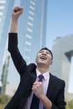 Businessman Cheering, Skyscraper in Background Stock Images