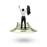 Businessman cheering and standing on money flying carpet Royalty Free Stock Image