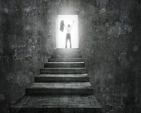 Businessman cheering on top of stairs with open door Stock Photos