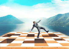 Businessman on the chess board Royalty Free Stock Images
