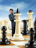 Businessman on the chess board Stock Photography