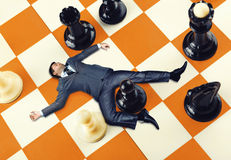 Businessman on the chess board Stock Photo